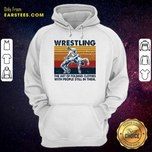 Wrestling The Air Of Folding Clothes With People Still In Them Vintage Hoodie- Design By Earstees.com